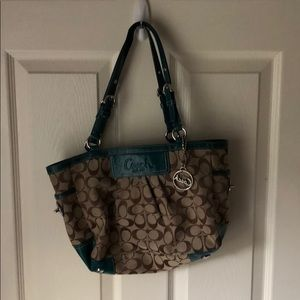 Teal coach purse
